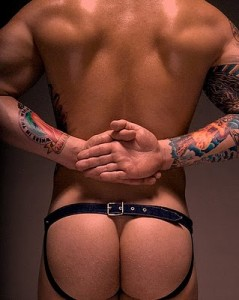 An attractive transexual male in a strap on and his cute butt